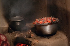 The ugali was kept warm with embers placed on top of the lid while other dishes were cooked.